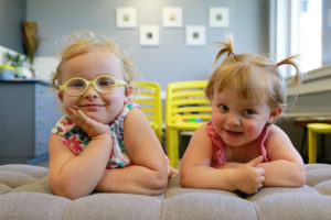 Two young girls relaxing on the waiting room bench