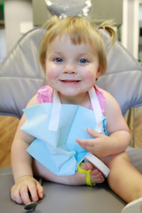 Toddler in the treatment chair, smiling