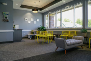 View of the waiting room at Willow Lake Dental featuring comfortable chairs and benches