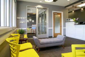 View of the waiting room and front entry at Willow Lake Dental