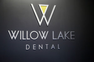 Photo of the Willow Lake Dental Logo from behind our front desk