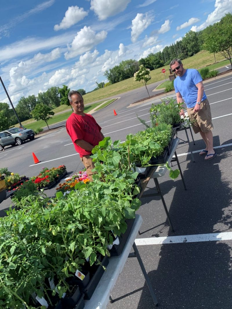 Mark buying vegetable and herb plants at the Vadnais Heights Farmers Market